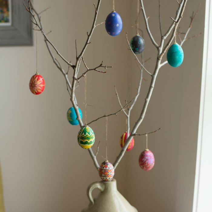 Easter decoration colored Easter eggs branch hanging up