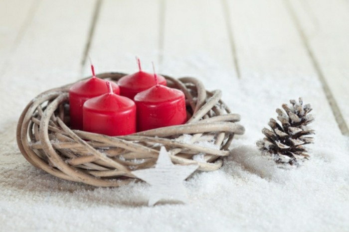 wood branches with red vintage candles