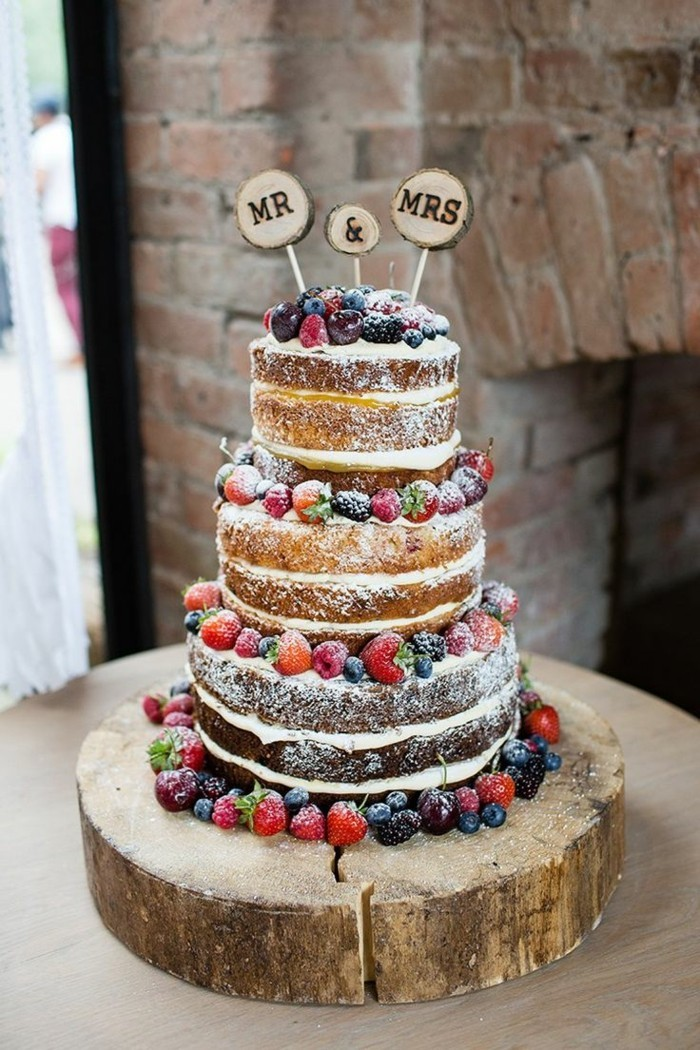 wedding cake in boho style with fruits and icing sugar