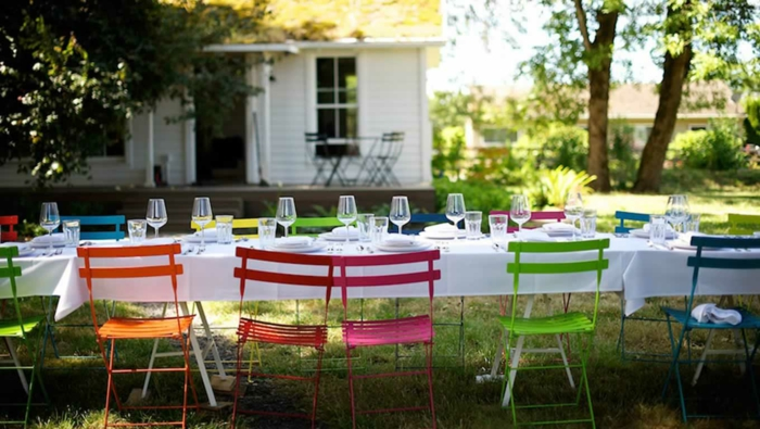 summer party deco white tablecloth colored garden chairs