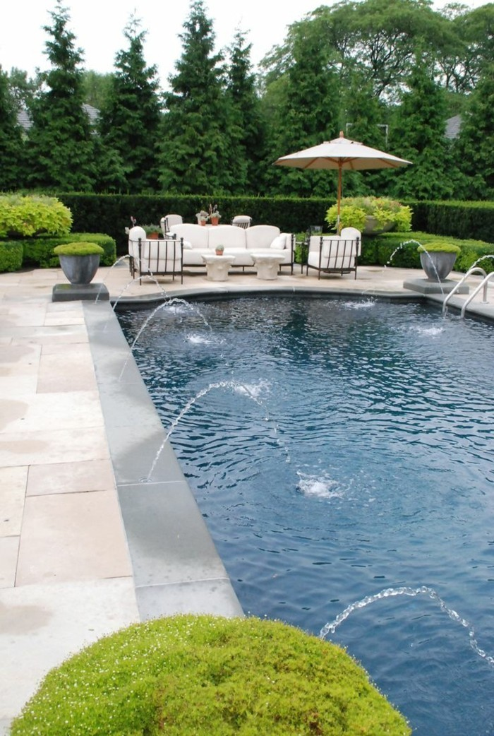 Swimming pool with fountain in one