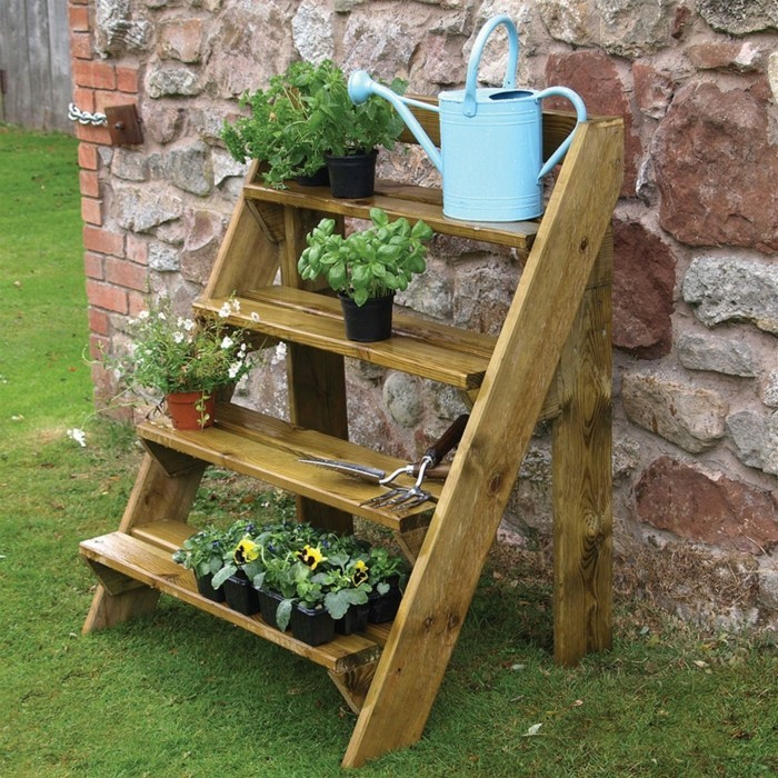 Wooden ladder full of flowers