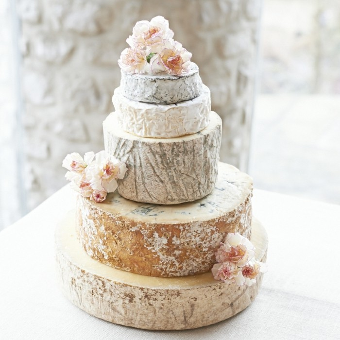 salty wedding cake decorated with flowers
