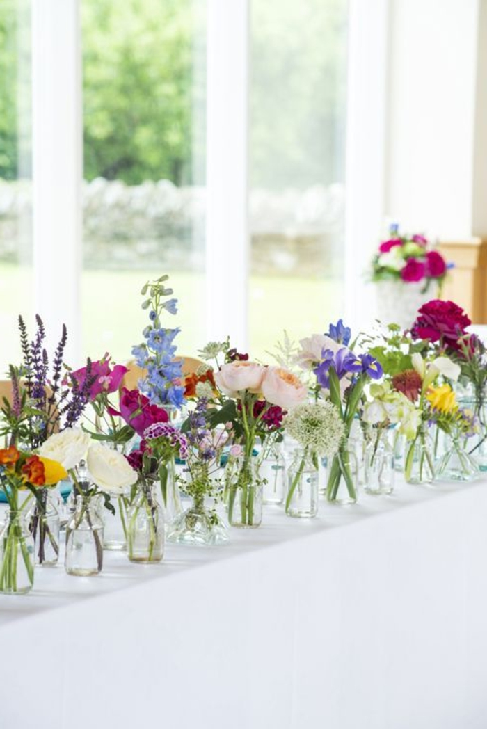 windowsill decoration colored flowers glass vases