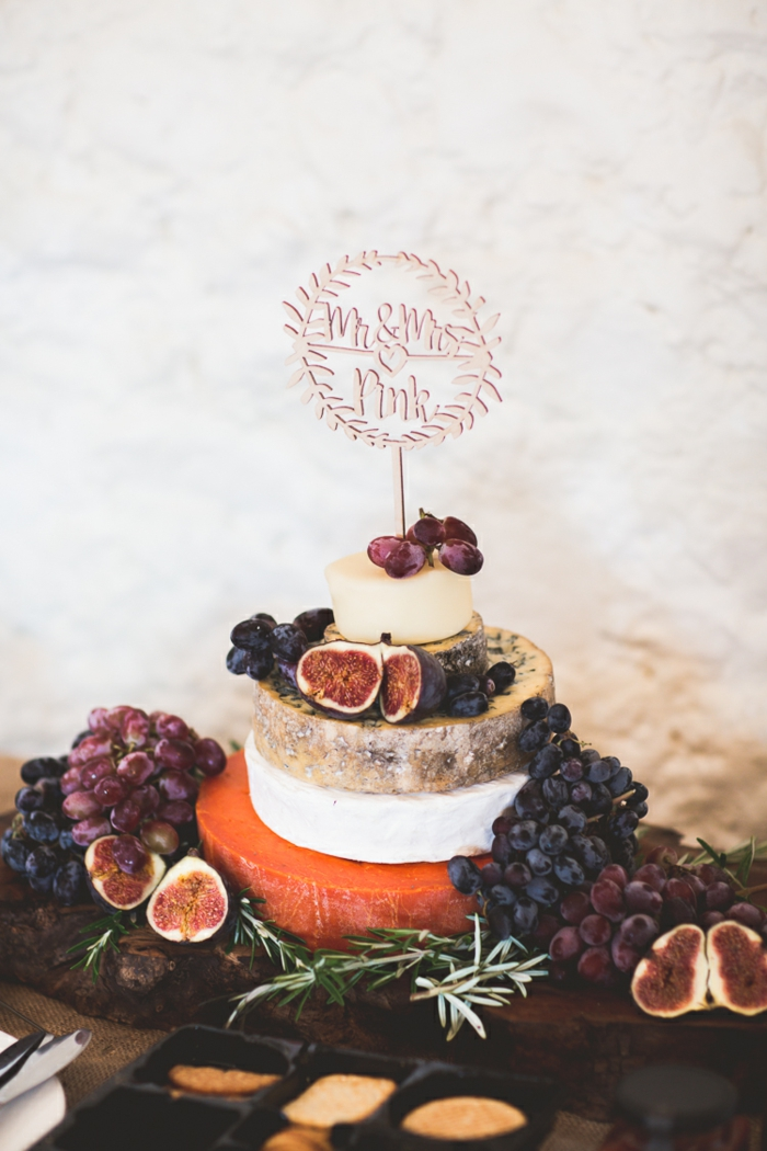 Wedding cake made from cheese with grapes and figs