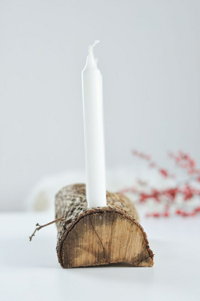 wooden stem white candle rosehips
