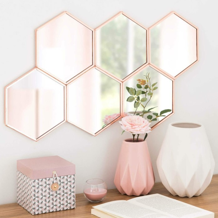 hexagonal mirror with a pale pink frame