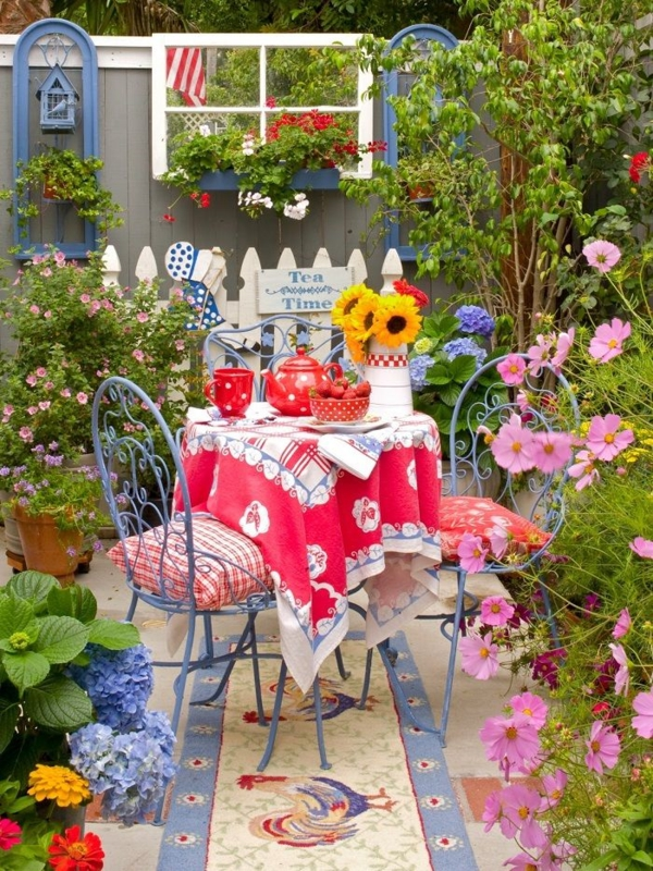 tea time in the garden garden furniture wrought iron colorful ceiling stone flooring