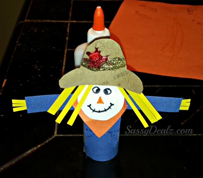 making autumn with children make autumn decoration yourself crafting with paper rolls scarecrow 1