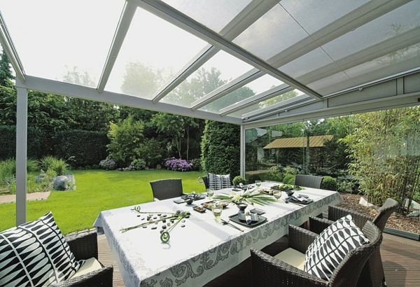 glass roof terraces outdoor furniture table rattan chairs
