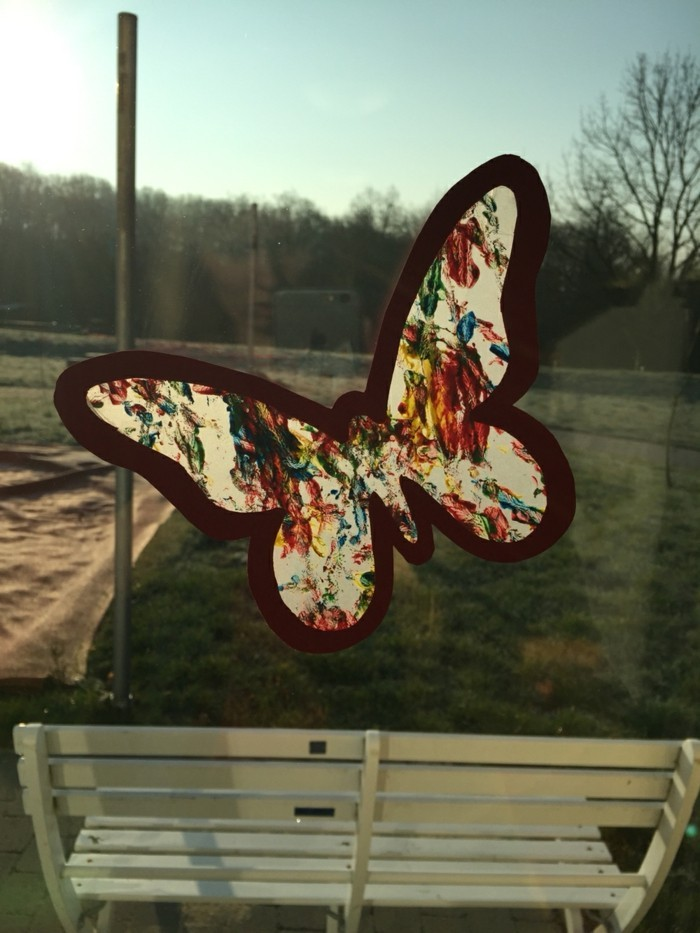 Making windowpane with children's butterfly