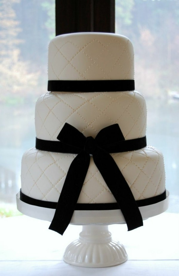 black white wedding cakes on several stages