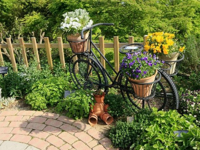 Creative gardening ideas for small gardens. Bicycle. Brown
