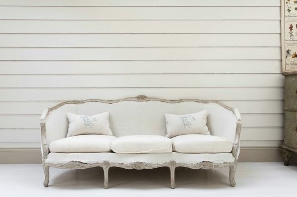 white sofa in front of white wall