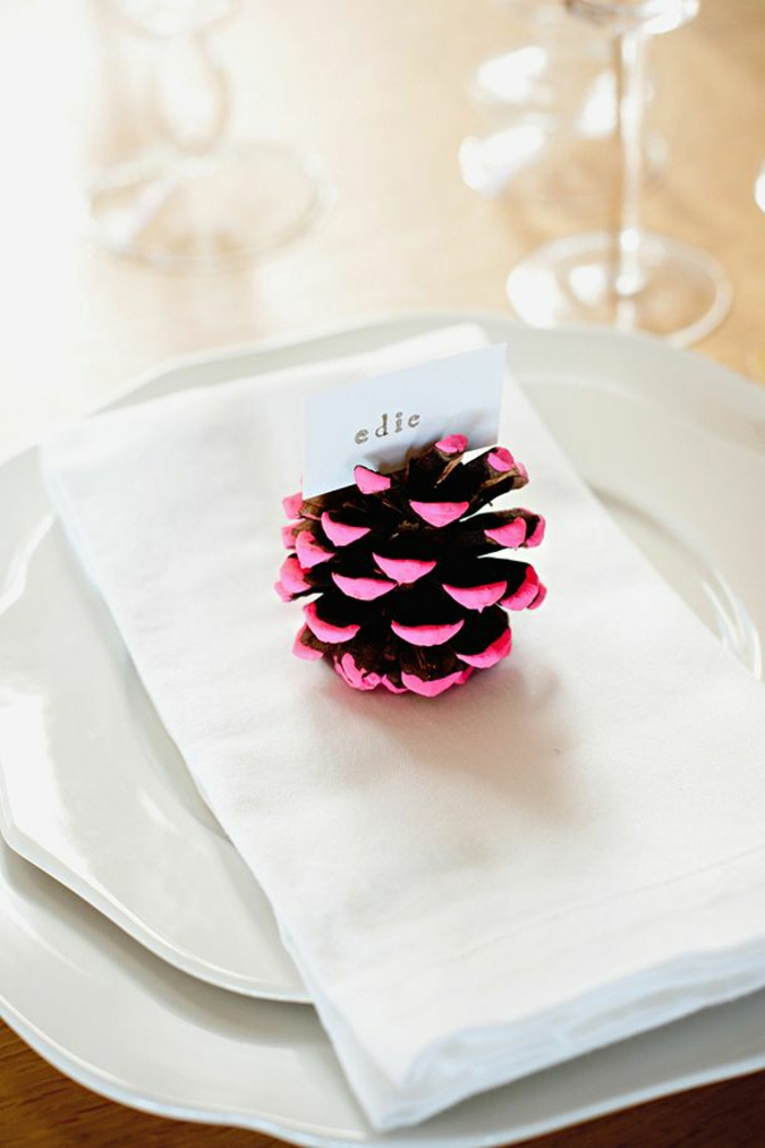 crafting christmas table decorations with pine cones
