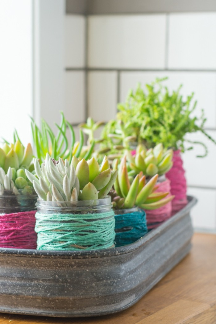 Use gardening jars as flower pots and decorate