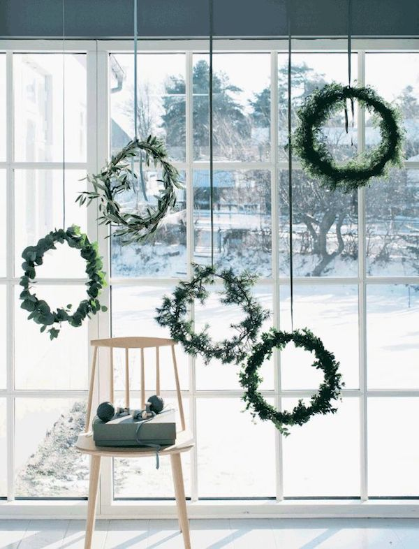 hanging christmas candle green on neutral ribbons