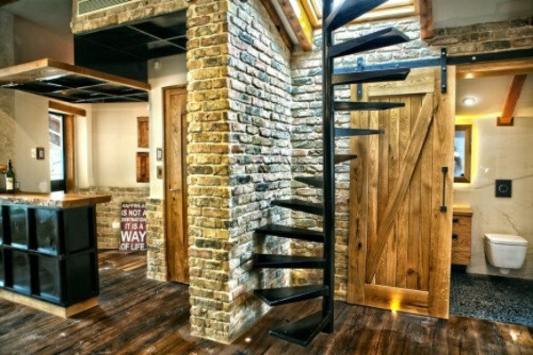 room with spiral staircase stone walls decoration ideas