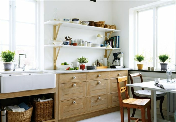 small kitchen set up wooden cabinets white floor plants