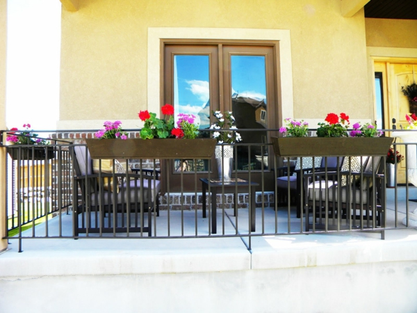 terrace plants dark brown flower boxes outdoor furniture