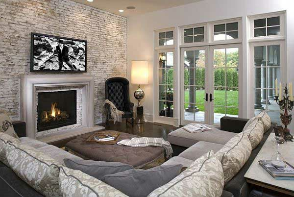 stone wall living room corner sofa coffee table fireplace