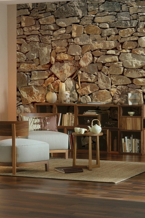 rustic stone wall living room comfortable armchair side table