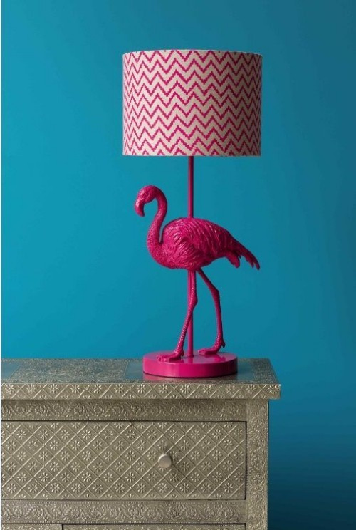 Flamingo decoration in front of a blue wall