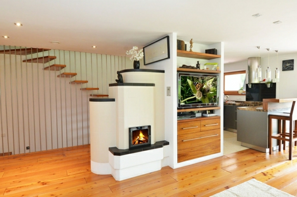 Fireplaces and tiled stoves partition wooden floor living area staircase