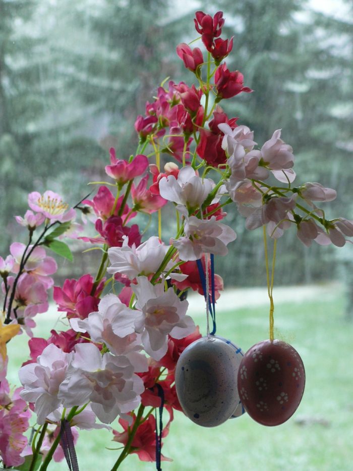 easter decorating easter eggs hanging flowers decorating windowsill decorating
