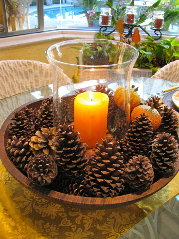 table decoration autumn many pine cones collecting