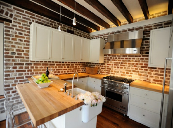 modern country house kitchen brick wall wooden work surface
