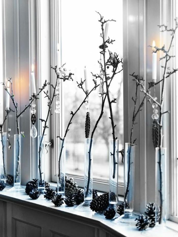 windowsill decoration christmas cones glass vases branches
