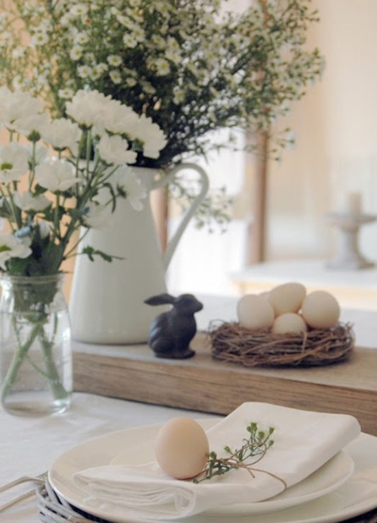 Table decoration for easter flowers vases bunny easter eggs typical symbols