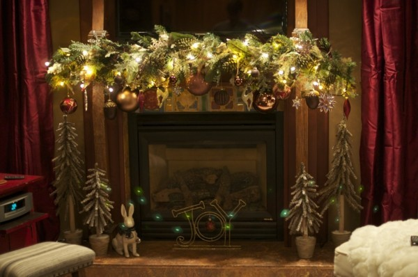 Homemade fireplace decoration with fir branches and Christmas balls