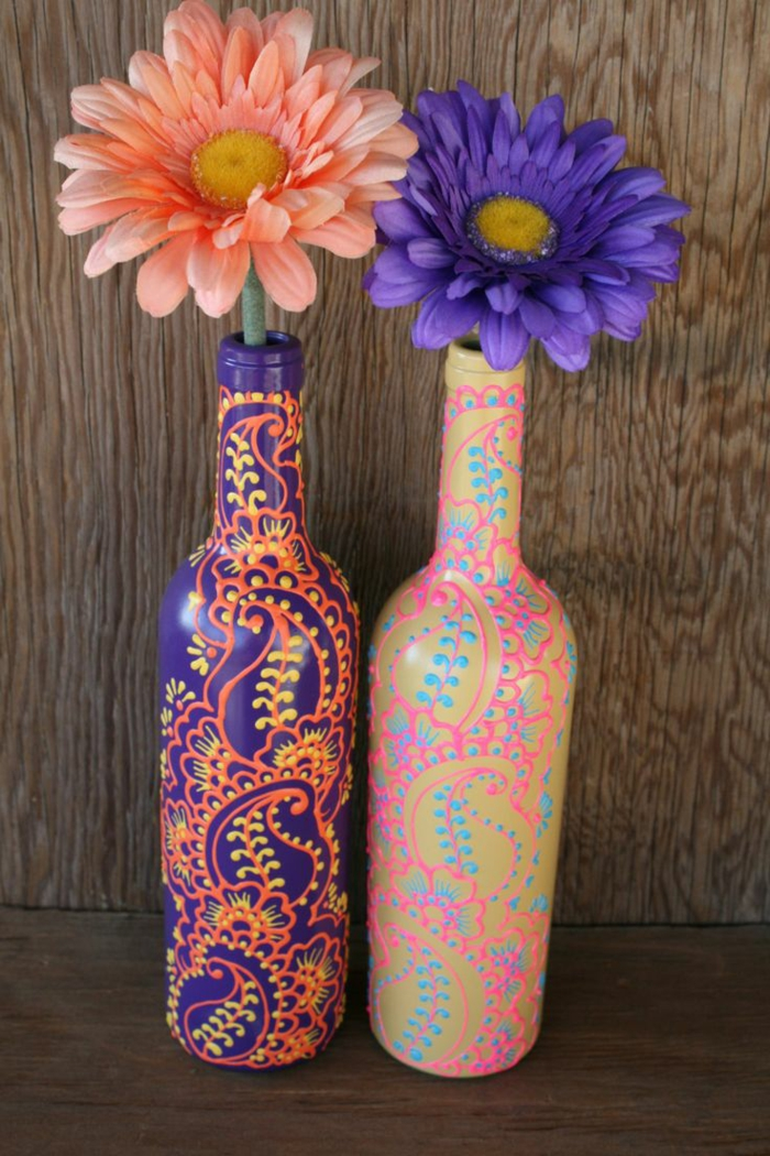 Decorated bottles of paint colored flowers