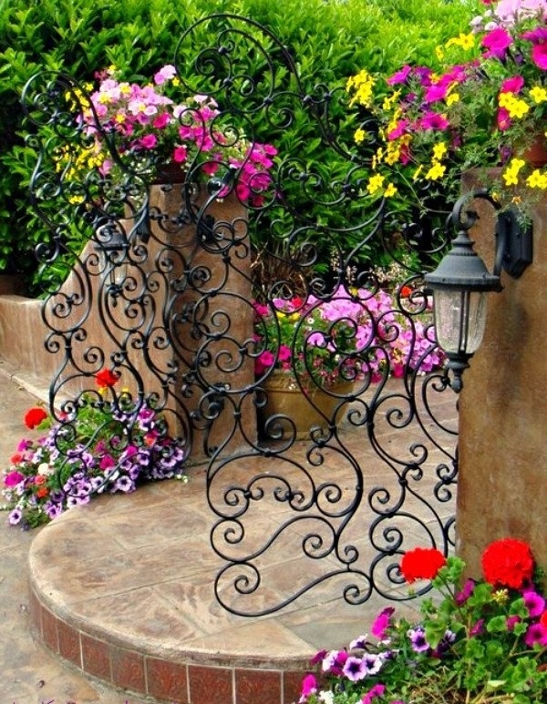 gardening gate wrought iron colorful plants