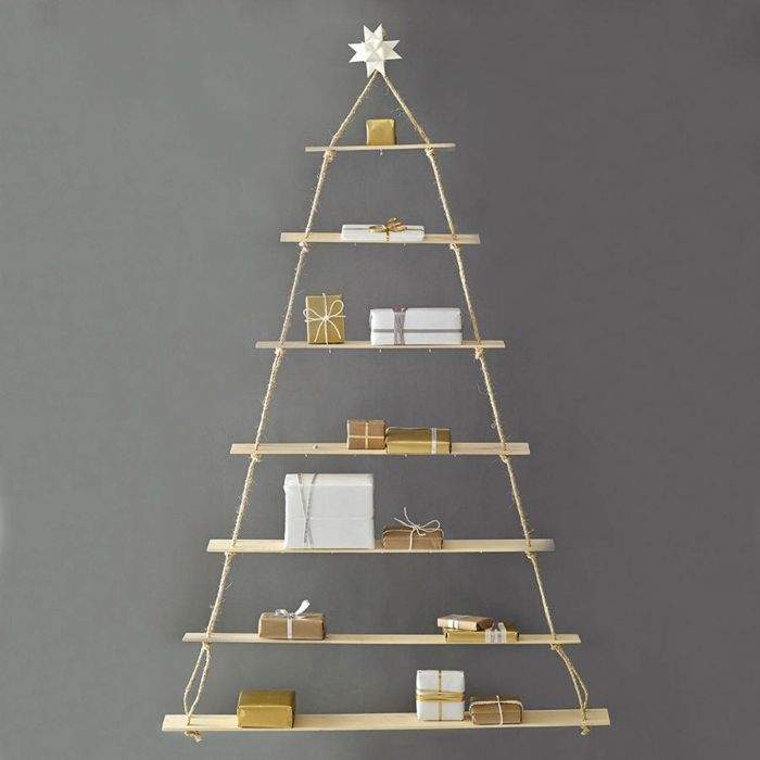 Artificially artificial Christmas tree test by wall shelf