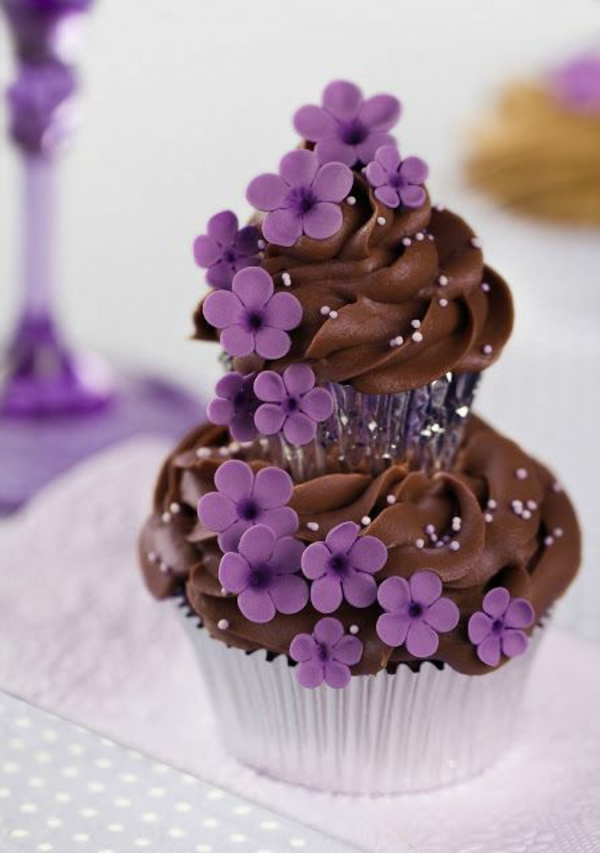 cake on top of each other chocolate purple flowers
