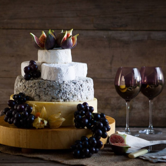 offering wedding cake with wine
