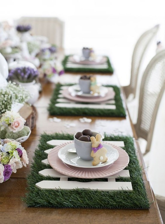 Table decoration Easter style and taste show beautifully decorated flowers Green rabbit chocolate eggs