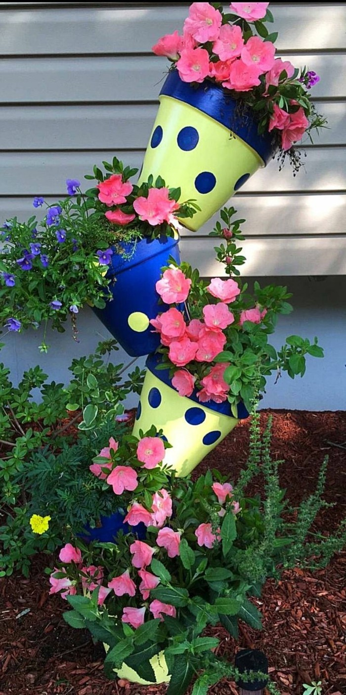 Ideas for the garden Colored flower pots act as a beautiful decoration in the garden