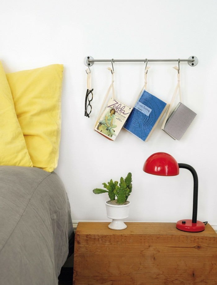 Flat decorating books hanging over the nightstand