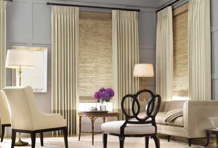 View protection in the modern living room. Cream-colored curtains