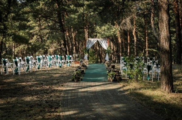 white green chairs wedding outside