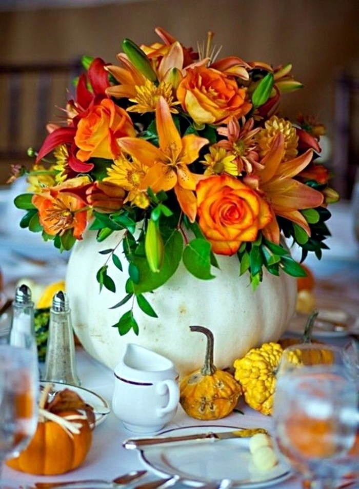 Decorate table decoration with pumpkins and flowers
