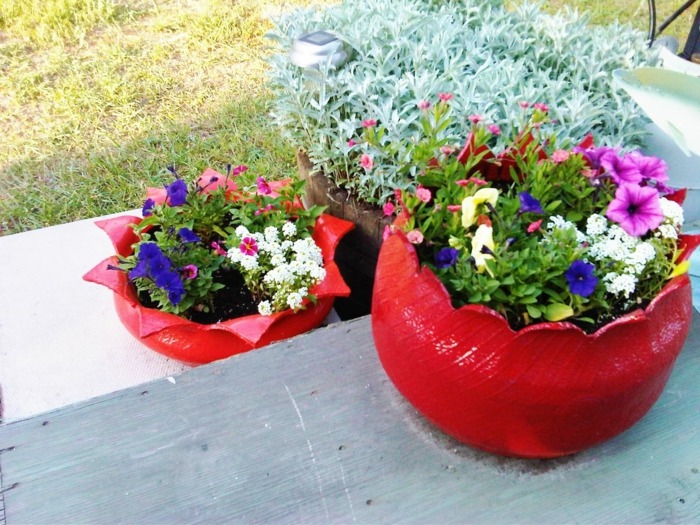 garden ideas old car tires red paint colored flowers
