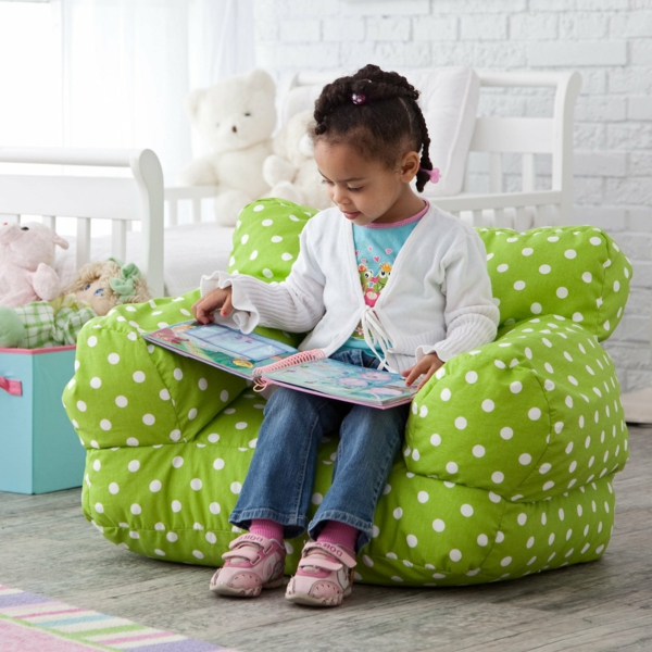 nursery green armchair reading white dots book