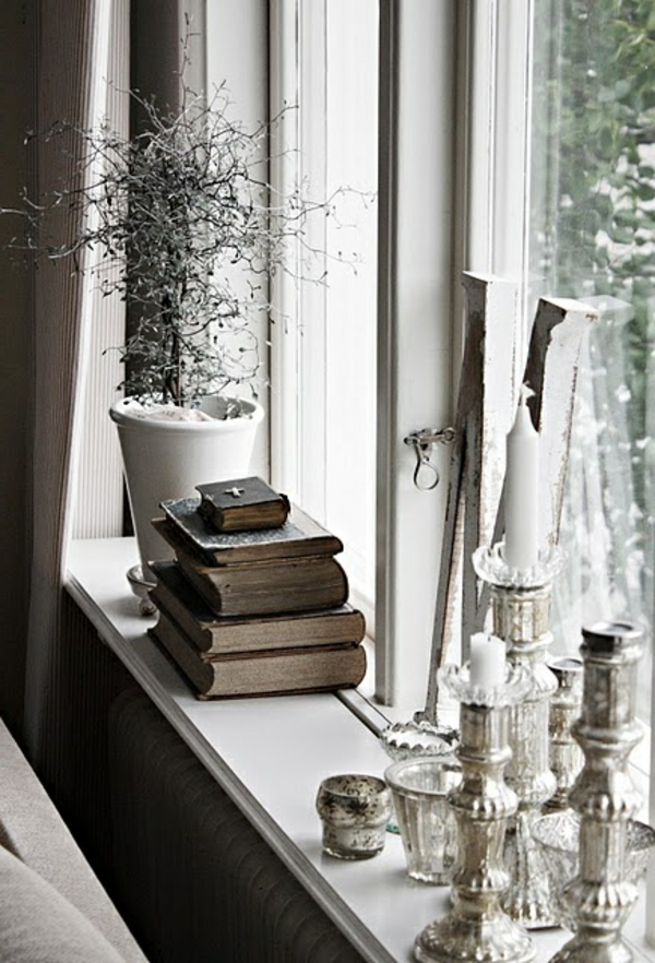 window sill deco stylish candles books plant