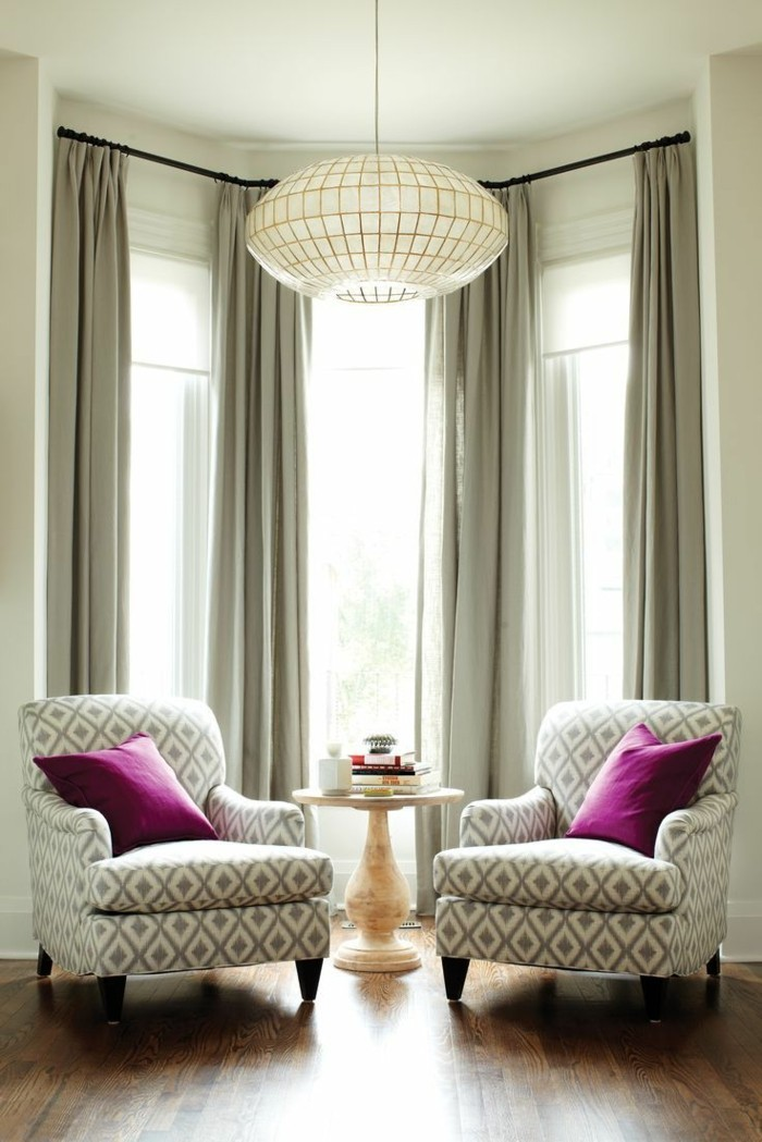 visual protection in the living area gray curtains that are inscribed into the interior design