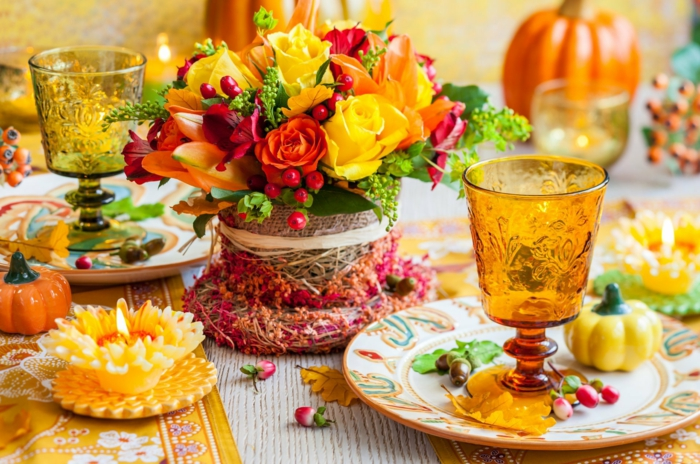 table decoration with autumn flowers and a lot of color